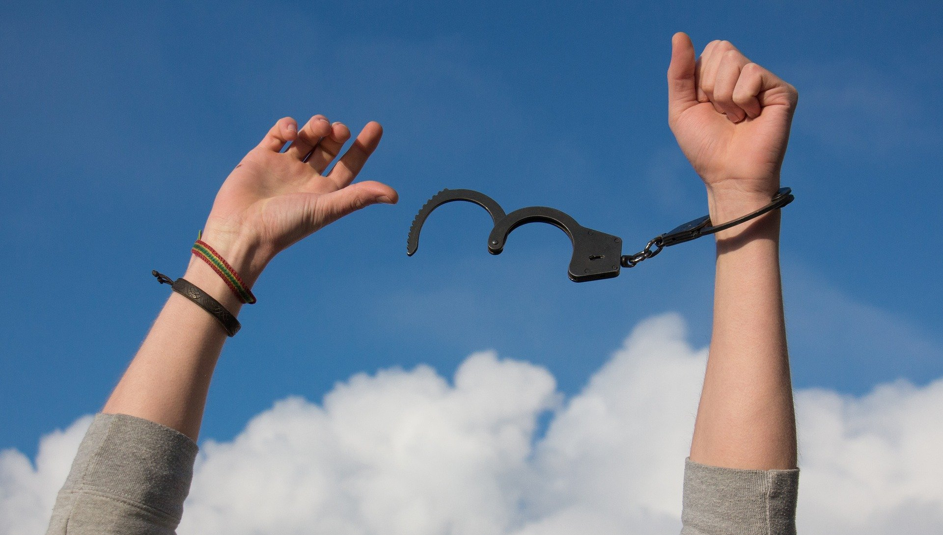 Sky- freedom-hands breaking handcuffs