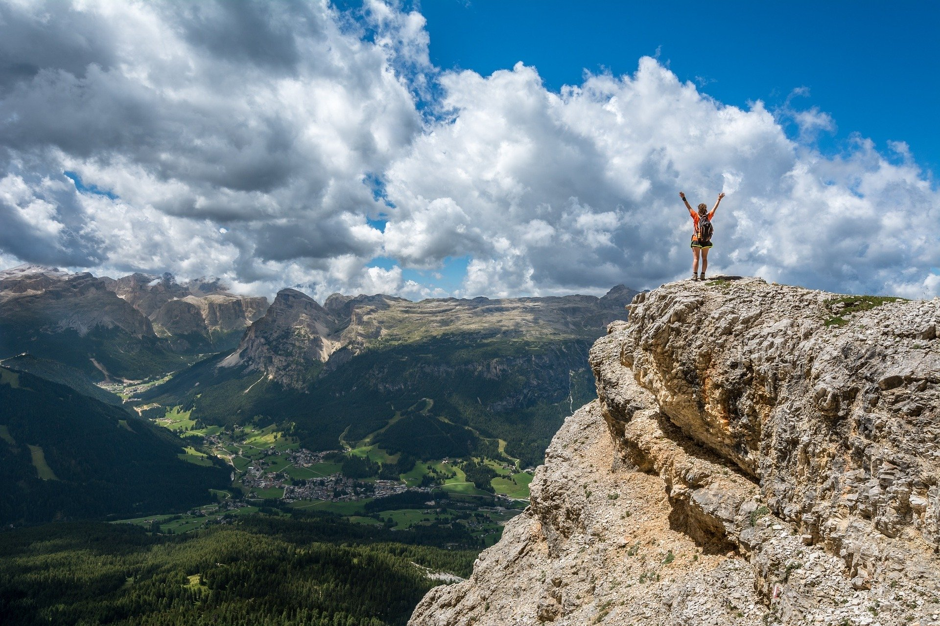 person standing on the mountain cliff
