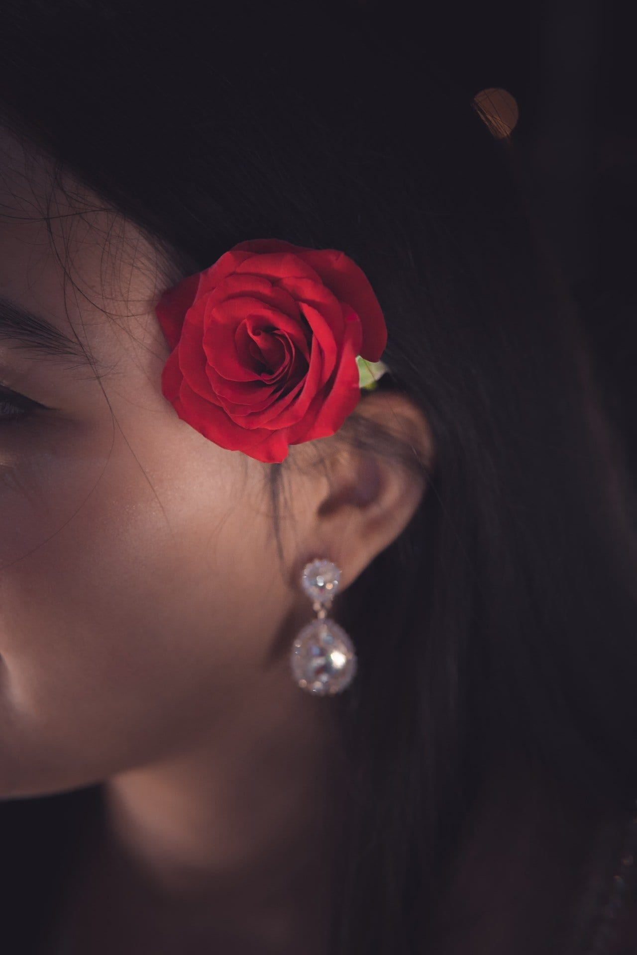 red-rose-on-women-s-ear-