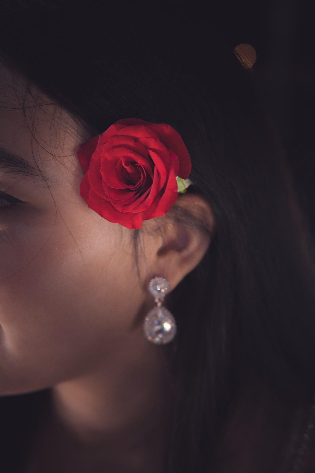 red-rose-on-women-s-ear-