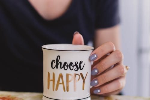 https://www.pexels.com/photo/selective-focus-photography-of-person-touch-the-white-ceramic-mug-with-choose-happy-graphic-704813/
