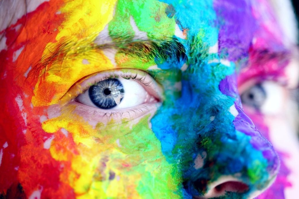 Person with lgbtq paint on face
