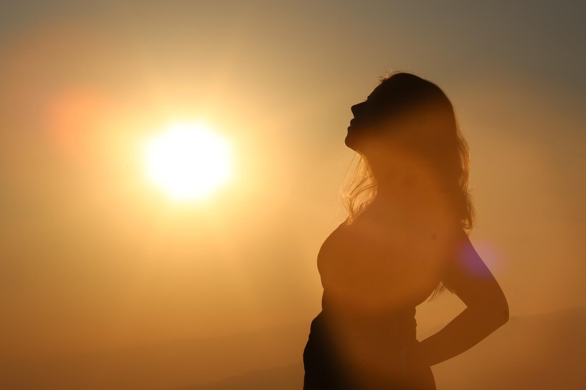 Women standing - sun