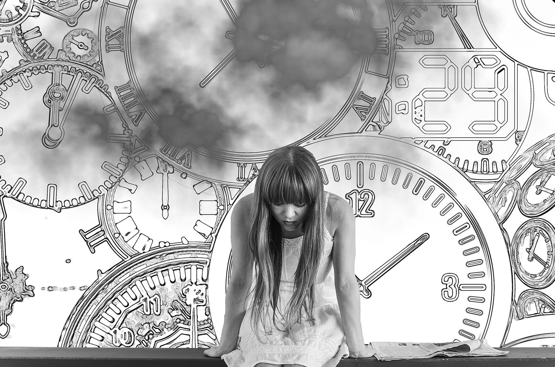 -ಮುಟ್ಟಿನ-Girl-sitting-face-down-clocks-in-the-background