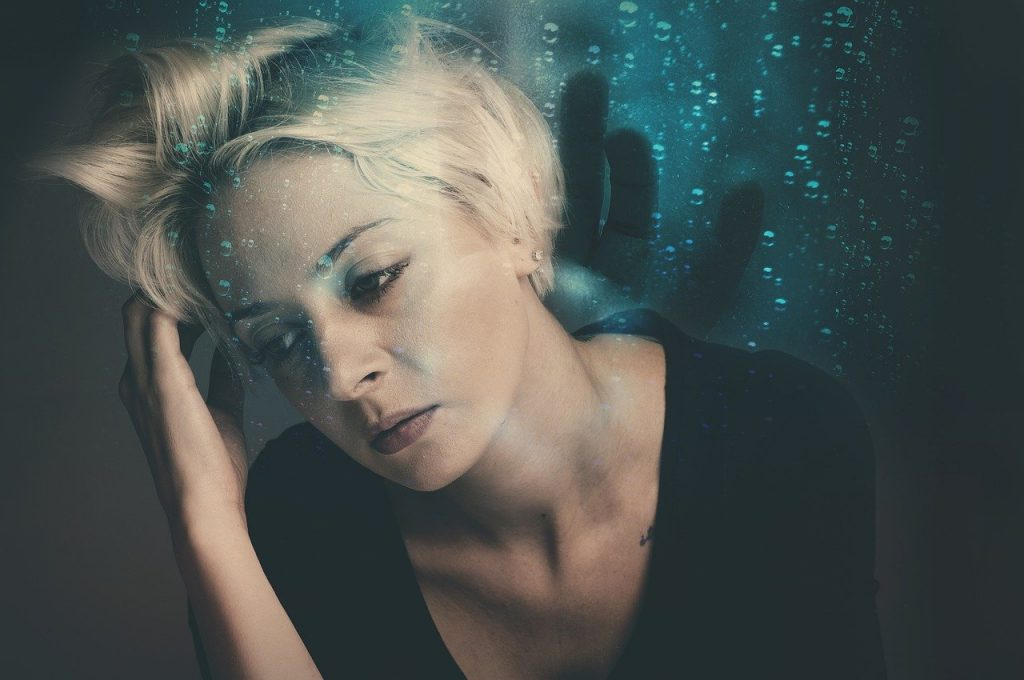 woman thinking about premenstrual